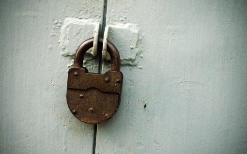 rusty lock on the grey gate